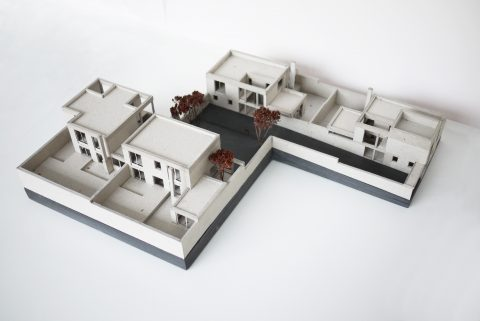 Cardboard and mdf model showing four mews houses arranged around a courtyard. The project is based near blackheath/ Greenwich, London by 31/44 architects.