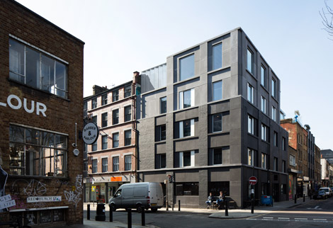 Redchurch Street, Shoreditch, Refurbishment and extension of a new hotel corner building using black concrete and brick piers.